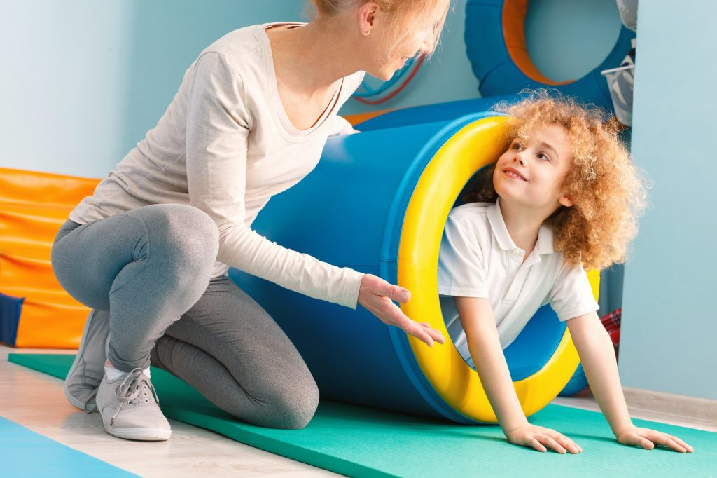 Boy exercising with therapist