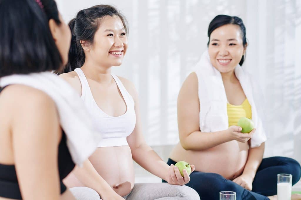 Pregnant women discussing maternity