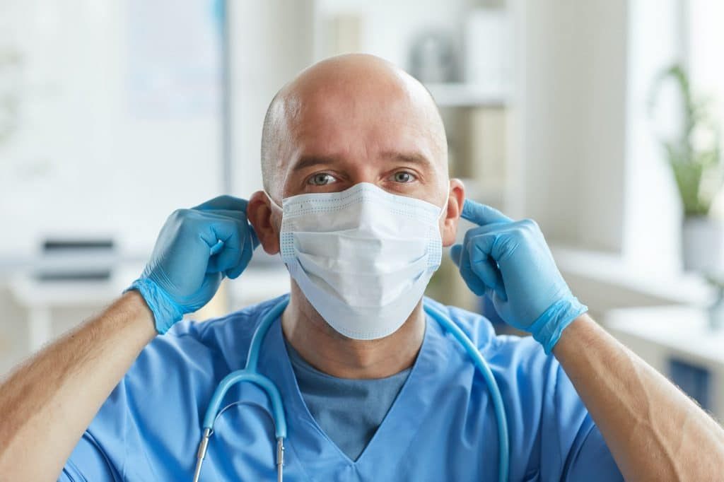 Doctor Putting On Mask